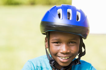 Young boy wearing bike helmet