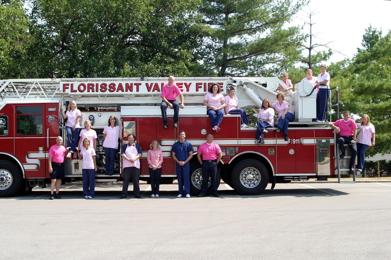 Firefighters and others in Pink Breast Cancer Awareness t-shirts
